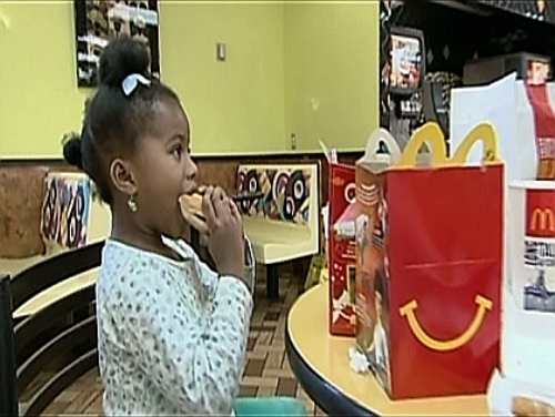 girl-eating-happy-meal