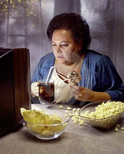 heavy-woman-watching-tv-while-eating-junk-food