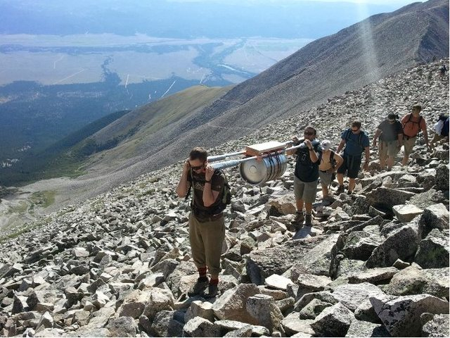 My Marine friends and I carried a keg up a 14,000 ft mountain for a bachelor party 711