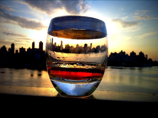 Manhattan sunset behind a glass of whiskey 990