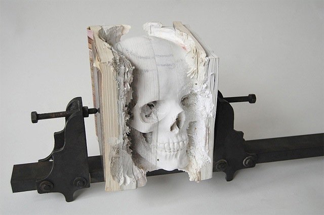 Skull carved from an old computer manual 223