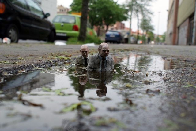Cement Eclipses by Isaac Cordal 722