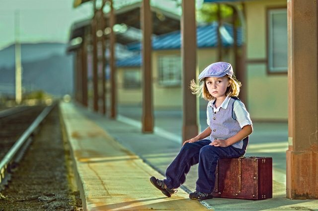 A little dude waiting for his train one morning 3b4n5j