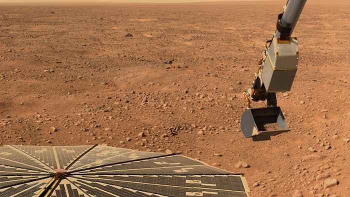 The Robotic Arm on NASA's Phoenix Mars Lander carries a scoop of Martian soil bound for the spacecraft's microscope